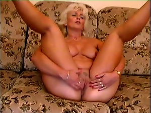 Mature blonde Amanda moans with pleasure while toying her pussy