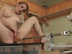 Lucy Fire the hot redhead babe uses a fucking machine in a kitchen