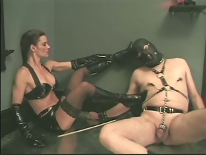 A dude in a mask gets dominated by his nasty mistress