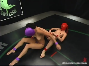 Two masked lesbians fuck each other with strapons on tatami