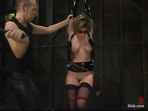 Honey in latex Tyle Wynn is being tied up and poked in her wet pussy