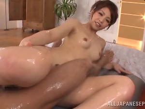 Slim Yuki Kami oils the guy up and rides his dick