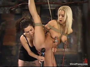 Busty blond cutie gets gagged and wired in her pussy