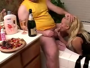 Chubby blonde mom enjoys licking a small cock in a bathroom