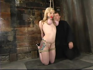 Suspended Adrianna Nicole gets her boobs twisted and tortured