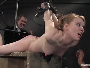 One is hogtied on the box and the other babe is tied up inside the box