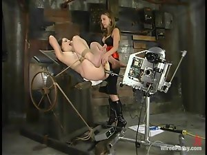 Lena Ramon gets tied up and introduced to a fucking machine