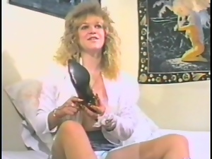 Blonde milf fingers her wet pussy in vintage clip