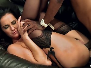 Gorgeous brunette babe in stockings gets rammed by Black dude