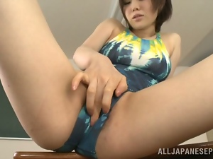 Nanako Mori plays with her Asian cunt in the classroom and gets facialed