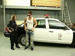 Sexy policewoman rides big cock near her police car