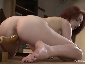 Redhead teacher Cameron Love plays with a sex machine in a classroom