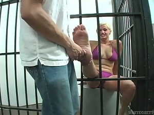 Jailed blond bitch is sucking a cock for freedom