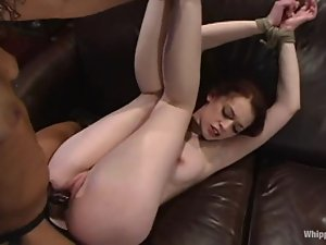 Redhead Justine Joli sucks a strap-on and gets toyed