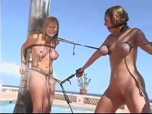 Three girls get tied up and dominated on a beach