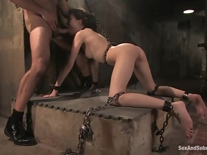 Sasha Grey gets tormented and mouth-fucked in a basement