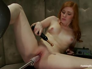 Nice redhead chick gets her pink pussy drilled by a machine
