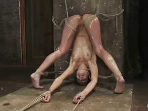 Flexible sex slave is being tied up and fisted hard