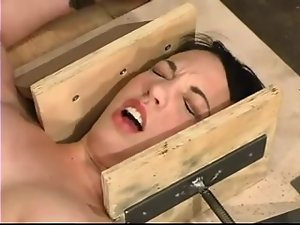 Sexy brunette siren Bella is being trapped in the device