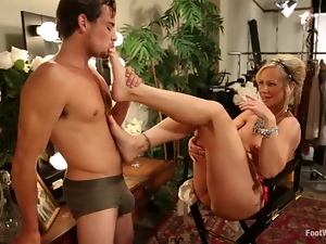 Brunette MILF gives nice footjob and gets nailed