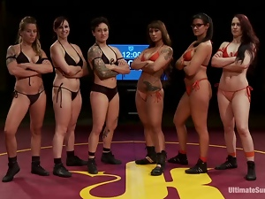 Kinky girls fight in a ring and then have wild lesbian orgy