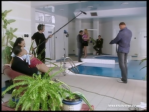 A blonde cutie gets fucked and facialed by two men on a poolside