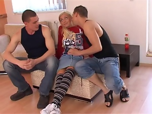 Delightful Tanja sucks and rides two dicks with great pleasure
