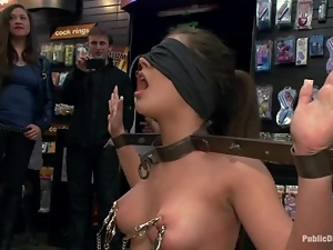 Amazing brunette girl gets fucked in both holes in a shop