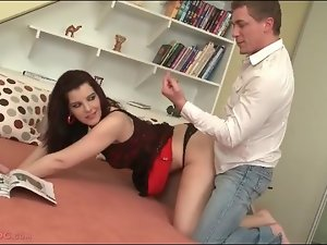 Young brunette in lingerie gives erotic BJ