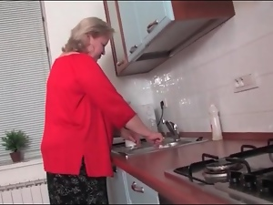 Fat old lady strips and rubs her pussy