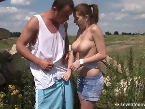 Big tits teen in wet top sucks dick outdoors