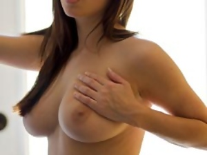 Stunning brunette Taylor Vixen strips off and tit fucks a dildo