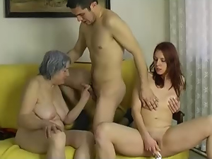 Grey haired grandma takes part in kinky FFM threesome with young guys