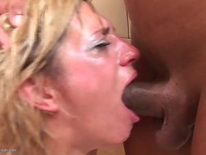 Blonde gags on cock in the toilet
