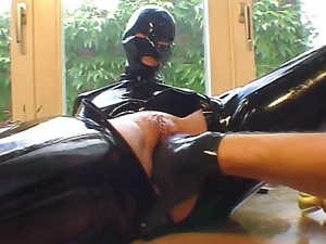 Gloved hand fucking in rubber