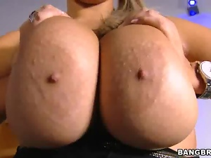 MASSIVE tits on this busty blonde