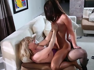 Hot strap on cock action with two babes