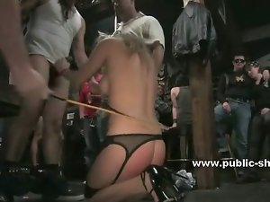 Redhead tied in a van gets abused by men and woman