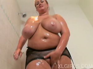 Fat chick with fuckable huge boobs in the shower