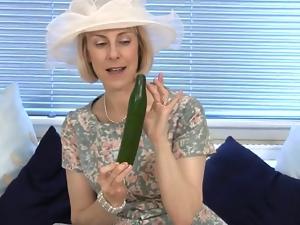 Mature housewife fucks a cucumber