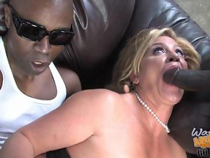 Slutty MILF babe shags with black dude in front of her son