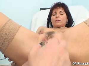 Classy MILF bitch gets her old pussy examined by kinky doctor