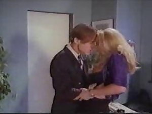 Blonde Office Secretaries Working Hard