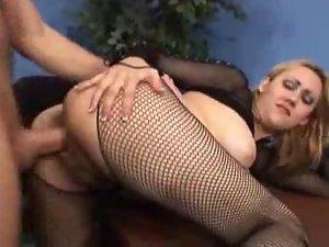 Blonde woman in black lingerie sucks cock