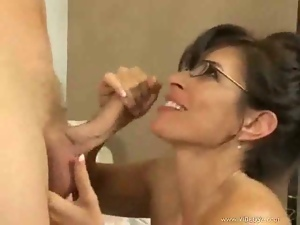 Mature woman with black glasses fucks younger man