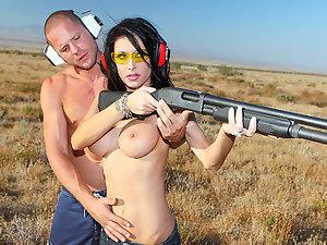 Busty brunette Jessica Jaymes goes gun shooting