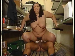 Look at this fat woman fucking in a kitchen
