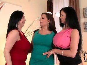 Three voluptuous lesbians suck on nipples