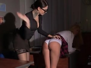 Schoolgirl over the knee of mistress and spanked