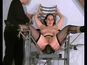 Her body shakes from the ass spanking pain